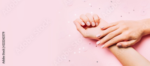 фотография Beautiful woman manicure on creative pink background