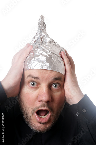 Fotografie, Obraz  crazy scared man wearing tin foil hat, paranoia or conspiracy theory concept