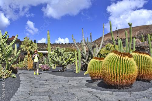 Deurstickers Canarische Eilanden Woman is walking in cactus garden, Jardin de Cactus in Guatiza, Lanzarote, Canary Islands, Spain