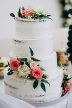 Wedding Cake With Red And Whit...