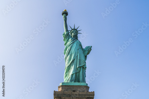 Fotografie, Obraz  The statue of Liberty  with blue sky background.