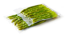 Asparagus Vacuum Sealed Ready For Sous Vide Cooking On White