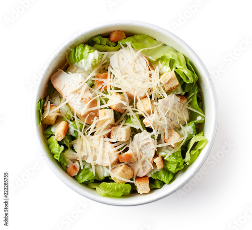 Cuadros en Lienzo Caesar salad in take away bowl on white background; from above