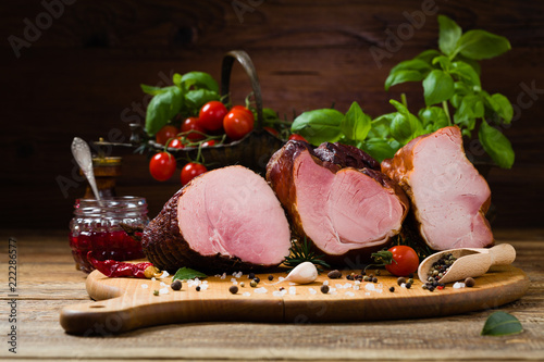 Smoked pork on wooden board.