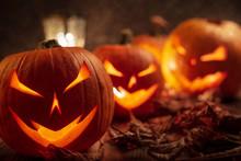 Carving Halloween Pumpkins On Wooden Plank Background.