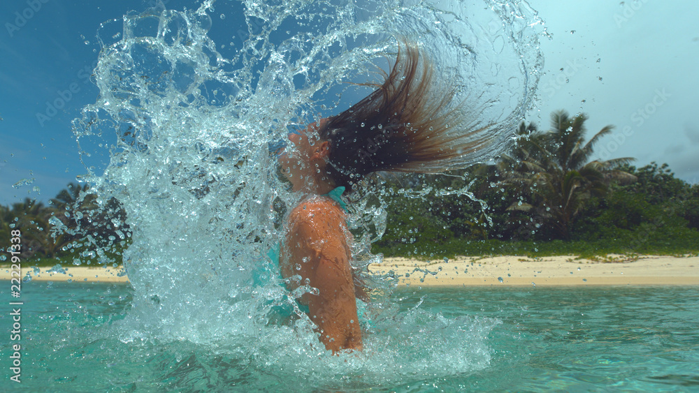 Fototapety, obrazy: CLOSE UP: Playful woman splashes glassy ocean water in air with her long hair.