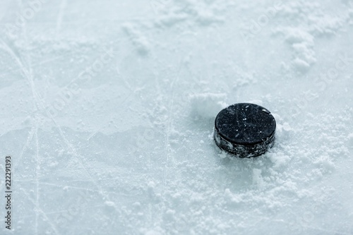 Hockey Puck on Ice Rink Canvas Print