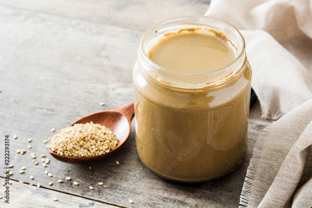 Fototapety, obrazy: Tahini and sesame seeds on wooden table