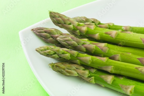 Asparagus on the Plate on Green Background