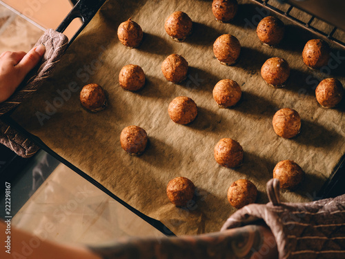 Valokuva  Hot prepared meat balls on baking sheet with paper