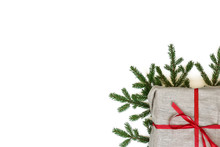Fir Branch / Twig And Burlap Canvas Christmas Gift Box On White Background. Christmas Border With Empty Blank Copy Space For Text.