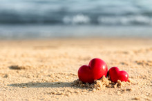Small Red Hearts On Beach Sand