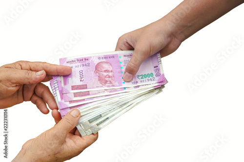 Fotografia  Hand Giving Indian 500 and 2000 Rupee Bank Notes over wheat background