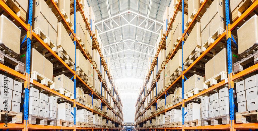 Obraz Rows of shelves with boxes in modern warehouse fototapeta, plakat