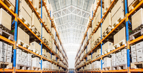 Obraz Rows of shelves with boxes in modern warehouse - fototapety do salonu