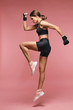 canvas print picture - Jump. Sport Woman In Sportswear Jumping On Pink Background