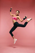 Jump Motion. Smiling Sports Woman Jumping In Sportswear