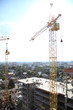 Working crane on the construction of the house. Construction of a residential multi-storey building. New residential area.