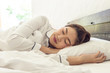 Beautiful Asian woman sleep and sweet dream on bed in bedroom in the morning,Healthcare Concept
