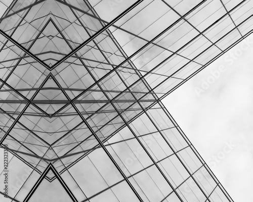 obraz PCV Perspective of modern glass window at skyscrapers - monochrome