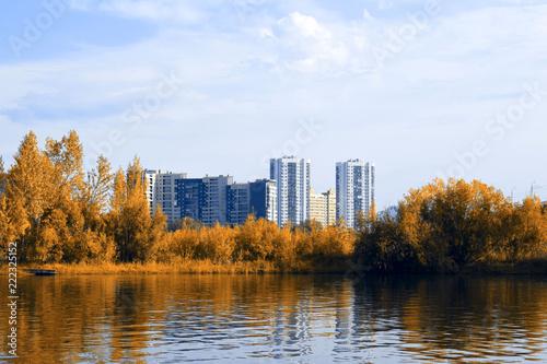 Fototapeta Krasnoyarsk city on the banks of the Yenisei river. Beautiful autumn in Siberia. Autumn landscape. Yellow foliage in the sun. obraz