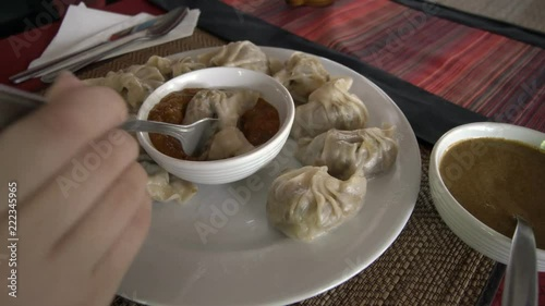 Eating Momo - Traditional Nepal Dish. Authentic Cuisine. Asian Food