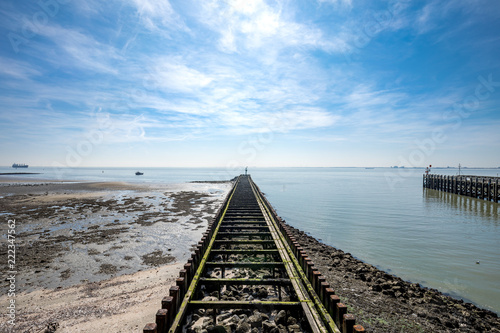 Old Broken Boardwalk Into The North Sea At Harbour Of Vlissingen Province Zeeland