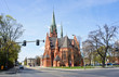 View of Church of St. Catherine, historic catholic temple, sunny day, Torun, Poland