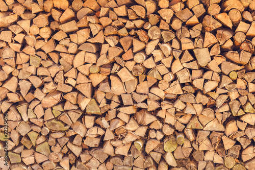Poster Firewood texture background of firewood stack