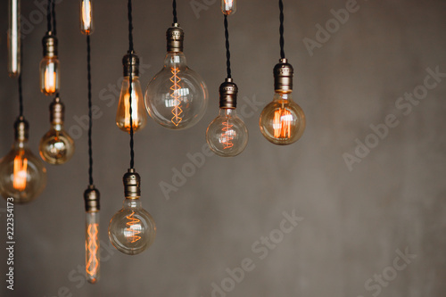 Cuadros en Lienzo Set edison retro lamp on loft gray concrete background