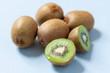 Fresh kiwi fruits on a pale blue background