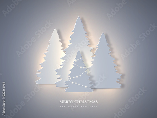 Fotografía  Christmas holiday banner with paper cut style fir-tree and glowing lights