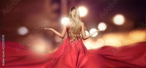 Fotografia Blonde lady in red elegant maxi dress.