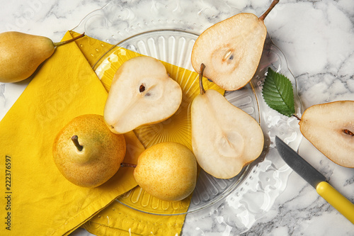 Flat lay composition with ripe pears on marble background