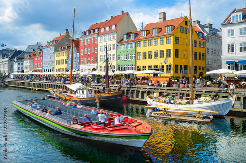 Photo  Touristic boat cruising by Nyhavn