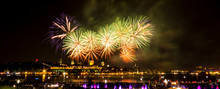 Orange And Green Fireworks In Front Of Quebec City During A Summer Festival.
