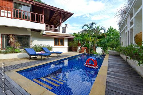 Fototapeta Interior and exterior design of pool villa with swimming pool ,home,house obraz na płótnie