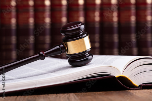 Wooden Gavel And Open Law Book