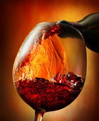Fototapeta Do steakhouse Red wine on an orange background