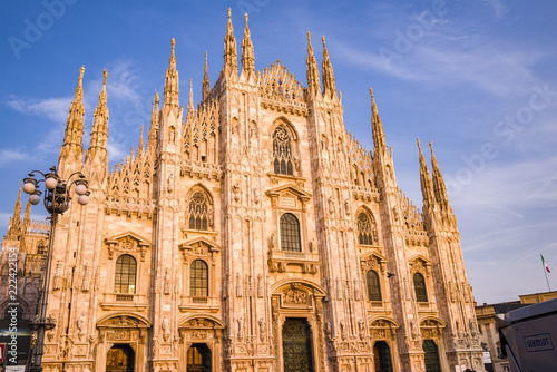 Fotografie, Obraz  Sunset, golden hour shines on the Duomo di Milano as seen from the Piazza del Du
