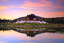Beautiful Reflection Of The Royal Ratchaphruek Park And Pavilion On During Sunset In Chiang Mai, Thailand