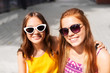 summer fashion, eyewear and people concept - smiling teenage girls in sunglasses outdoors