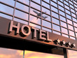 Leinwanddruck Bild - shiny hotel sign with stars