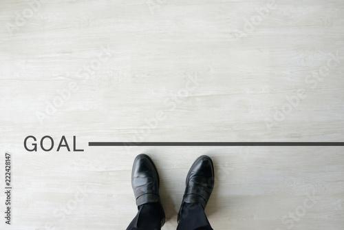 Foto ゴールラインに立つビジネスマン