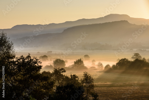 Agricultural field. Morning sunrise over rural countryside landsacpe.