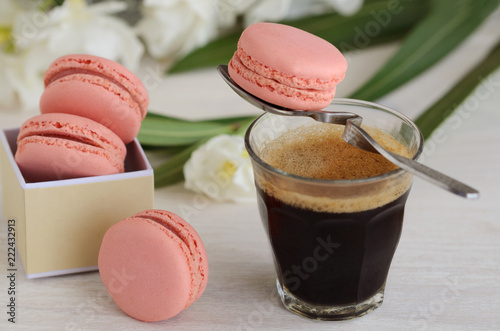 Staande foto Macarons Black coffee espresso and pink macarons dessert. Good Morning concept.