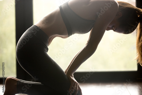 Fototapety, obrazy: Young sporty woman practicing yoga, doing breathing exercise, Uddiyana Bandha pose, working out, wearing sportswear, grey pants and top, indoor close up view, yoga studio. Pranayama concept