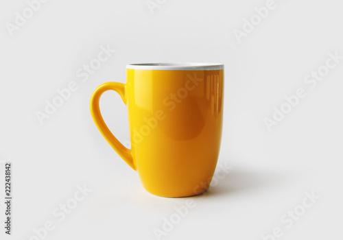 Blank yellow tea cup or coffee mug. Responsive design mockup.