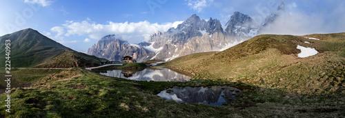 Poster Reflexion Panoramica delle Pale di San Martino con la Baita Segantini verso il tramonto
