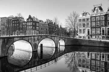 Beautiful sunrise view of the famous UNESCO world heritage canals of Amsterdam, the Netherlands, in black and white. Keizersgracht (Emperors canal)